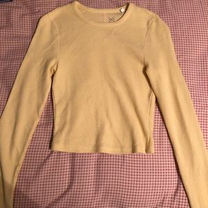 A yellow long sleeve shirt